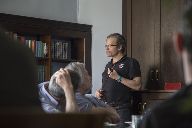 Peter Schwerdtfeger (centre), professor of theoretical chemistry, listens to a lecture. Photo: Camilla K. Elmar