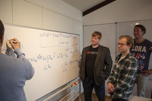 Paul Arne Østvær, professor of mathematics at the University of Oslo (UiO) together with three of his project participants at CAS. Photo: Marit Fiksdal / Centre for Advanced Study (CAS)
